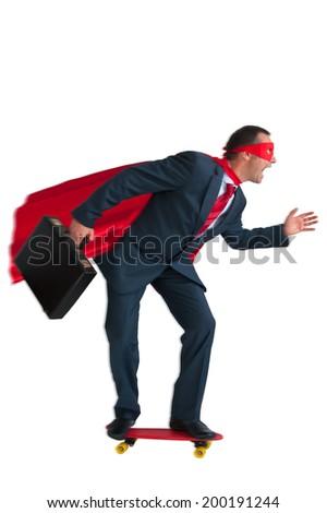 superhero businessman riding a skateboard isolated on white  - stock photo