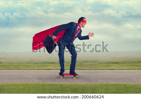 superhero businessman riding a skateboard making progress