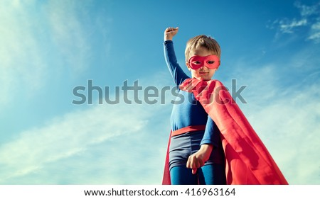 Superhero child concept for childhood, imagination and aspirations - stock photo