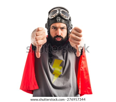 Superhero doing bad signal  - stock photo