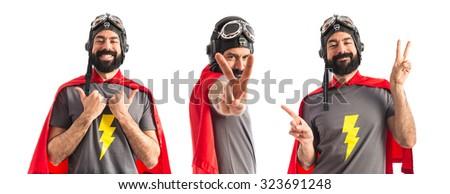 Superhero doing victory gesture  - stock photo