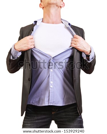 Superhero. Image of young man tearing his shirt off isolated on white background - stock photo