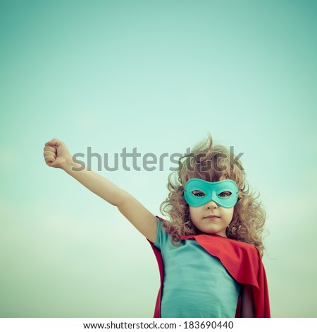 Superhero kid against summer sky background. Girl power and feminism concept - stock photo