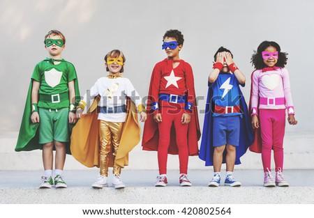 Superhero Kids Aspiration Imagination Playful Fun Concept - stock photo