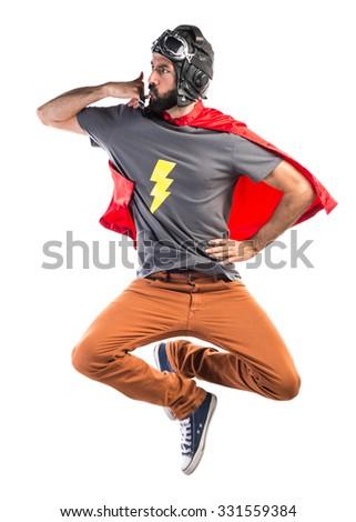 Superhero making phone gesture - stock photo