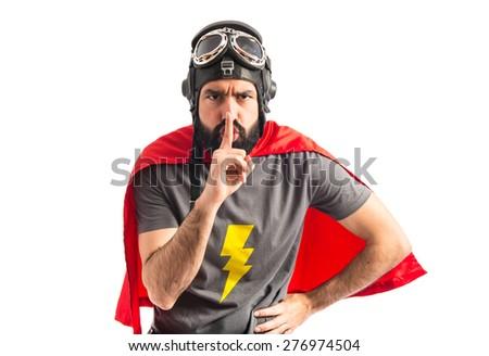 Superhero making silence gesture  - stock photo