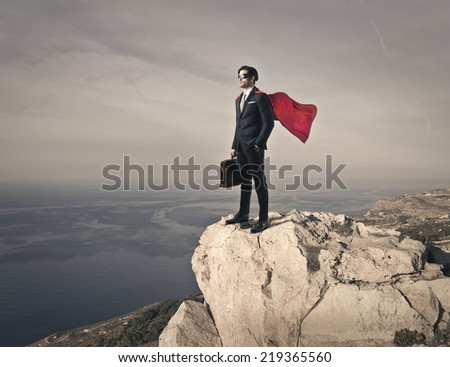 Superhero on the top  - stock photo