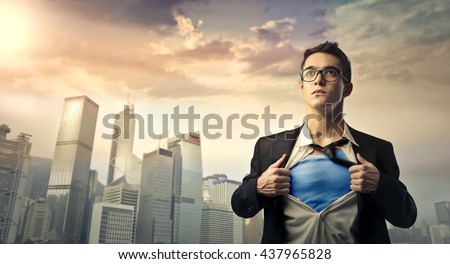 Superhero protecting the city - stock photo