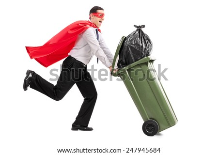 Superhero pushing a full trash can isolated on white background - stock photo