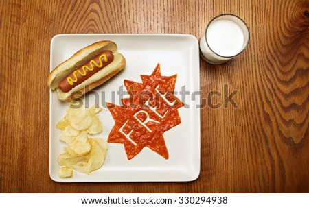 Superhero thought bubble made with ketchup. Free kids meal concept. Toned image - stock photo