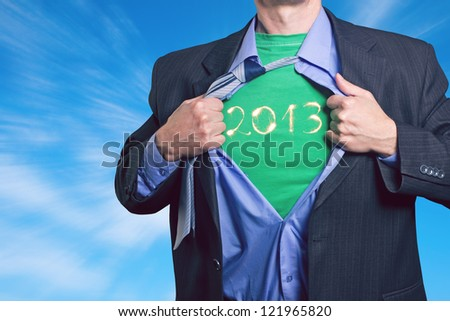 Superhero, young businessman tearing his shirt. The new year 2013 in the aim of our life. - stock photo