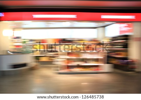 Supermarket aisle. Abstract blur - stock photo