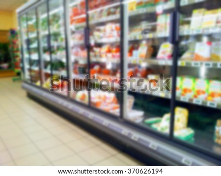 Supermarket aisle in a grocery store showing frozen foods - stock photo