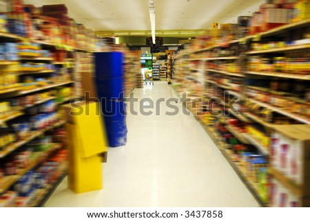 supermarket aisle with motion blur - stock photo
