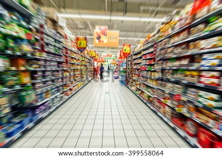 Supermarket blur food background with aisle