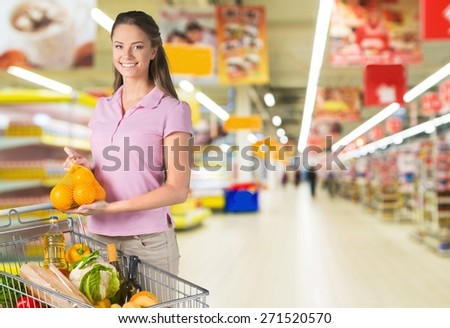 Supermarket. Handsome man shopping in grocery store for produce - stock photo