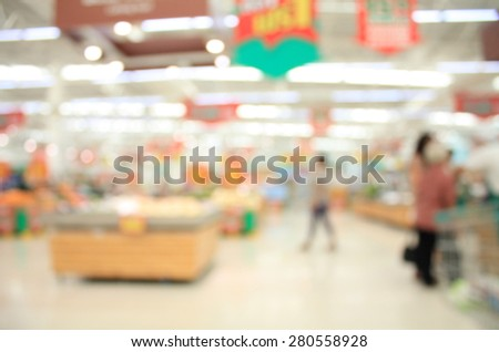 supermarket in blurry for background with customer - stock photo