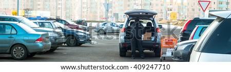 supermarket parking lot - stock photo
