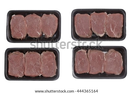 Supermarket plastic tray with veal isolated on white background. Top view
