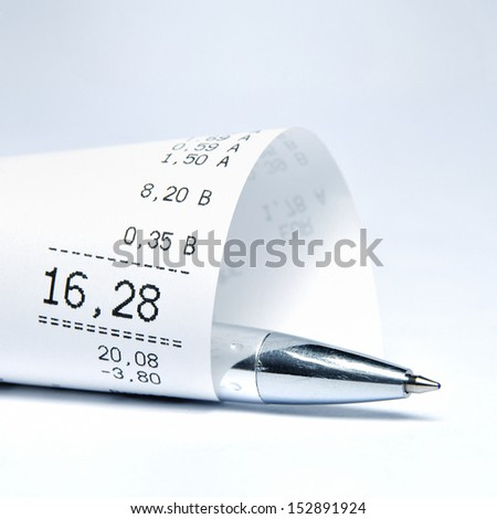 Supermarket receipt and ball pen - stock photo