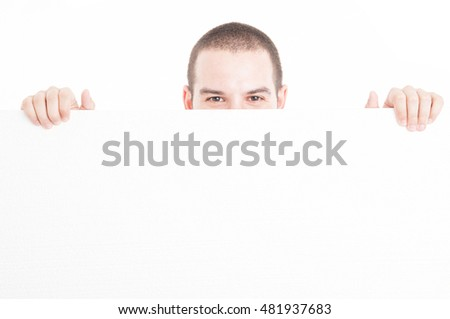 Supermarket seller hiding from big advertising board isolated on white background with copy text space