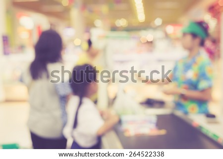 Supermarket store blur background ,Cashier counter with customer, Vintage filter effect - stock photo