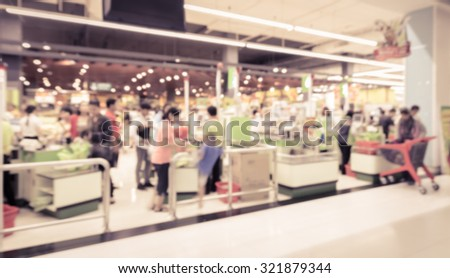 Supermarket store blur background ,Cashier counter with customer. Vintage filter effect image - stock photo