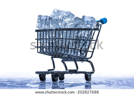 supermarket trolley with melting ice cubes - stock photo