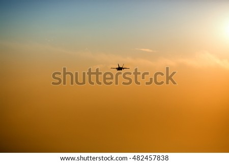 Supersonic jet during sunset