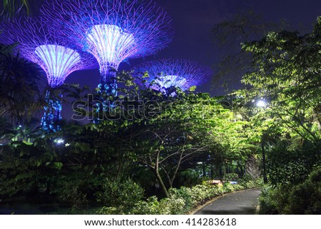 Supertree grove and footpath at night in Gardens by the Bay, Singapore - stock photo