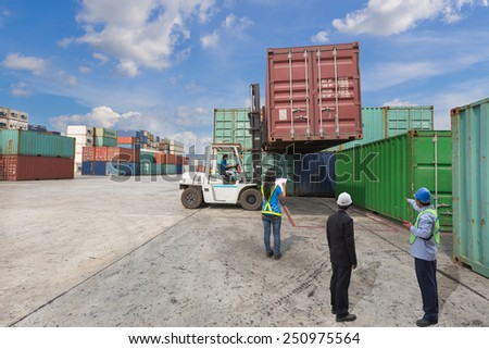 Supervisor and manager checking worker during working check information container box with forklift handling at dockyard - stock photo