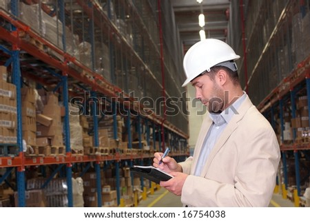 supervisor counting stocks - stock photo