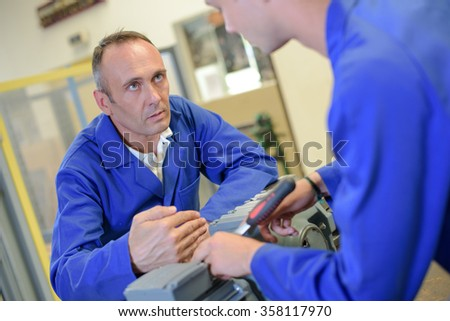 Supervisor talking to trainee - stock photo