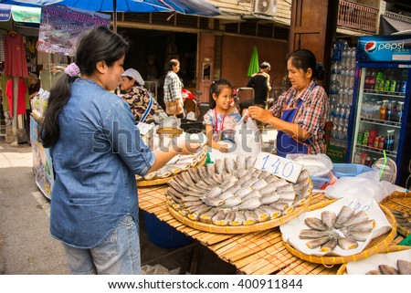 Suphan Buri, Thailand - Apr 3, 2016 -women sell dried fish at Samchuk market