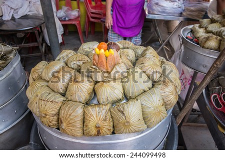 Suphan Buri, Thailand - November 23,2014 : Street Vendor selling Lotus leaf food at Samchuk old market  in Suphan Buri, Thailand. - stock photo