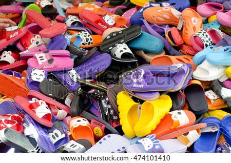 SUPHANBURI, THAILAND - August 25 : Thai people sale fashion sandals or slippers at local market on August 25, 2016 in SUPHANBURI, THAILAND