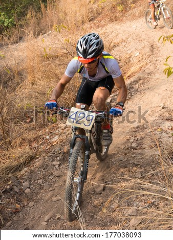 SUPHANBURI-THAILAND JANUARY 9 : A unidentified athlete in Men Cross country  Mountainbike  National Compettition  on January 9, 2014 at Khaopra XC Track Doembangnangbuat in Suphanburi, Thailand.