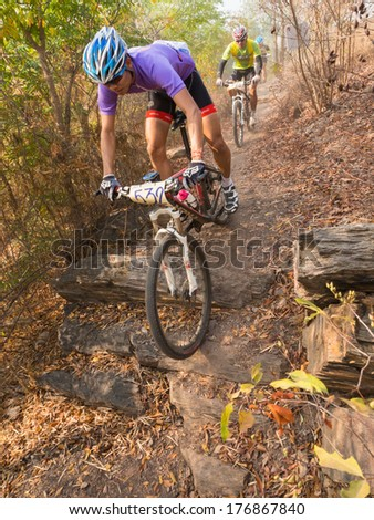 SUPHANBURI-THAILAND JANUARY 9 : Unidentified athletes in Men Cross country  Mountainbike  National Compettition  on January 9, 2014 at Khaopra XC Track Doembangnangbuat in Suphanburi, Thailand.