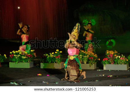 SUPHANBURI, THAILAND - NOVEMBER 28: Thai traditional dance to celebrate the Loy Krathong festival.Thai people float on water a small rafts (Krathong).November 28, 2012 in Suphanburi, Thailand.