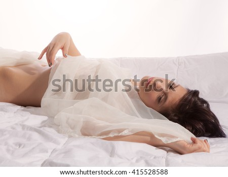 Supine Woman on Bed With Sheer White Fabric