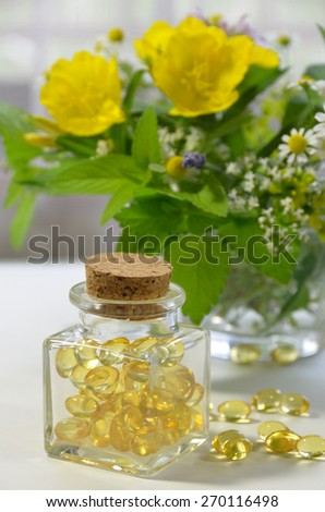 supplement with evening primrose and herbs - stock photo