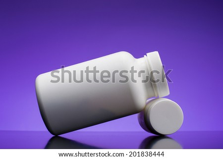 Supplements, medications or vitamin bottle on blue background