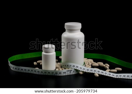 Supplements, medications or vitamins with bottle - stock photo
