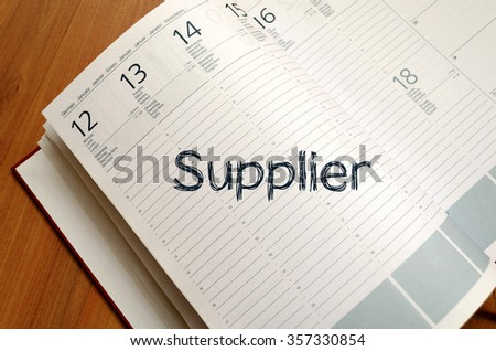 Supplier text concept write on notebook