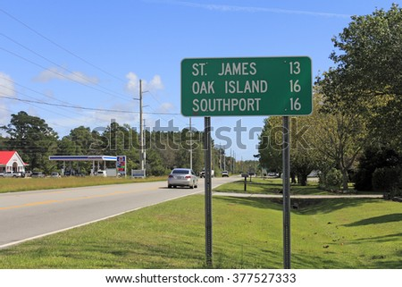 Supply, NC, USA - September 29, 2015: Road sign along 211 or Southport Supply Rd SE east towards St. James, Oak Island and Southport. Road sign in Supply, NC.
