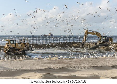 Supply of sand to the Dutch North Sea coast. - stock photo
