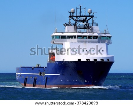 Supply Ship F, Offshore Supply Vessel underway at sea to offshore installation. - stock photo
