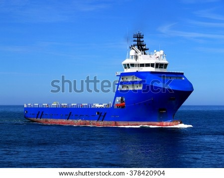 Supply Ship L, Offshore Supply Vessel underway at sea to offshore platform. - stock photo