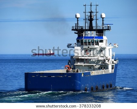 Supply Ship, Offshore Supply Vessel underway at sea heading for offshore installation. - stock photo