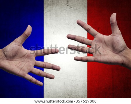 Support and assistance human hands over france flag background - stock photo